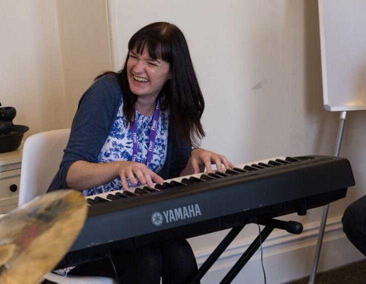 Photograph of Rebecca playing piano